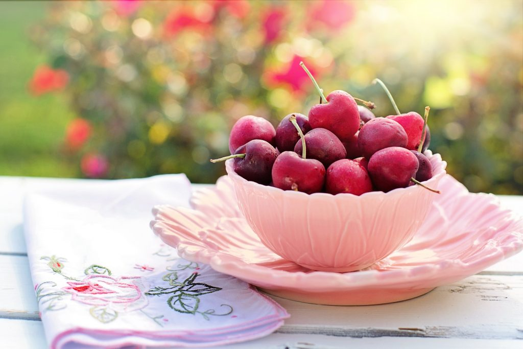 Cherries in a pink bowl