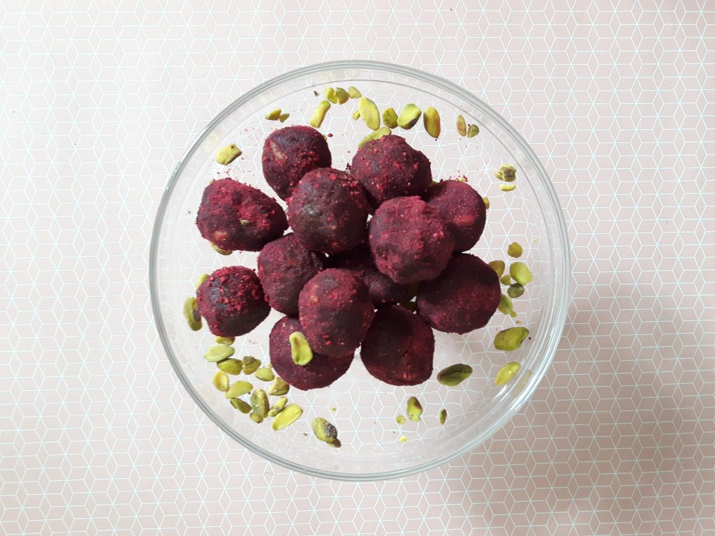 bliss balls with raspberries and pistachios