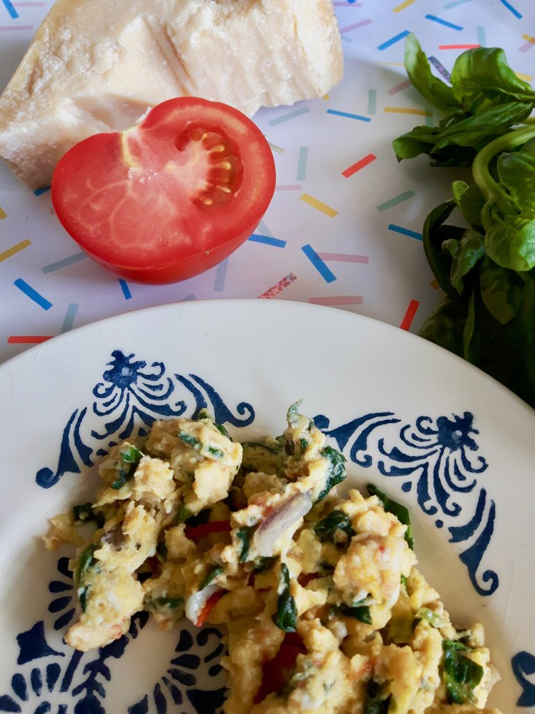 scrambled eggs parma, tomato and basil