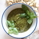 pesto in a bowl with cashews