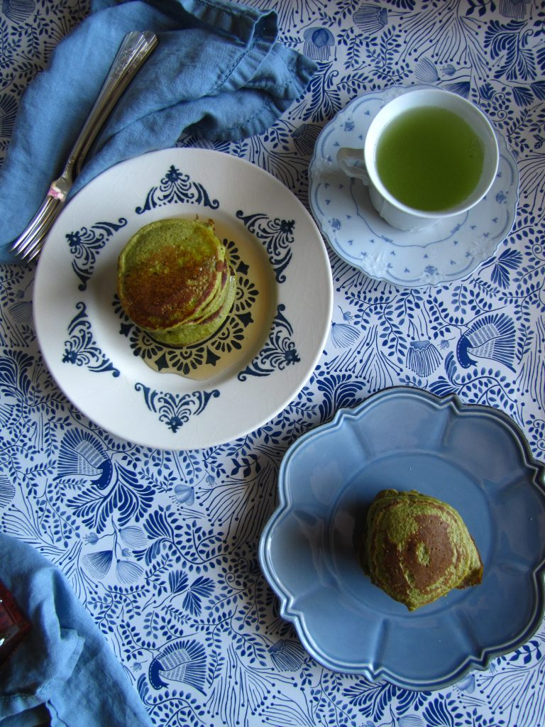 Matcha pancakes on two plates