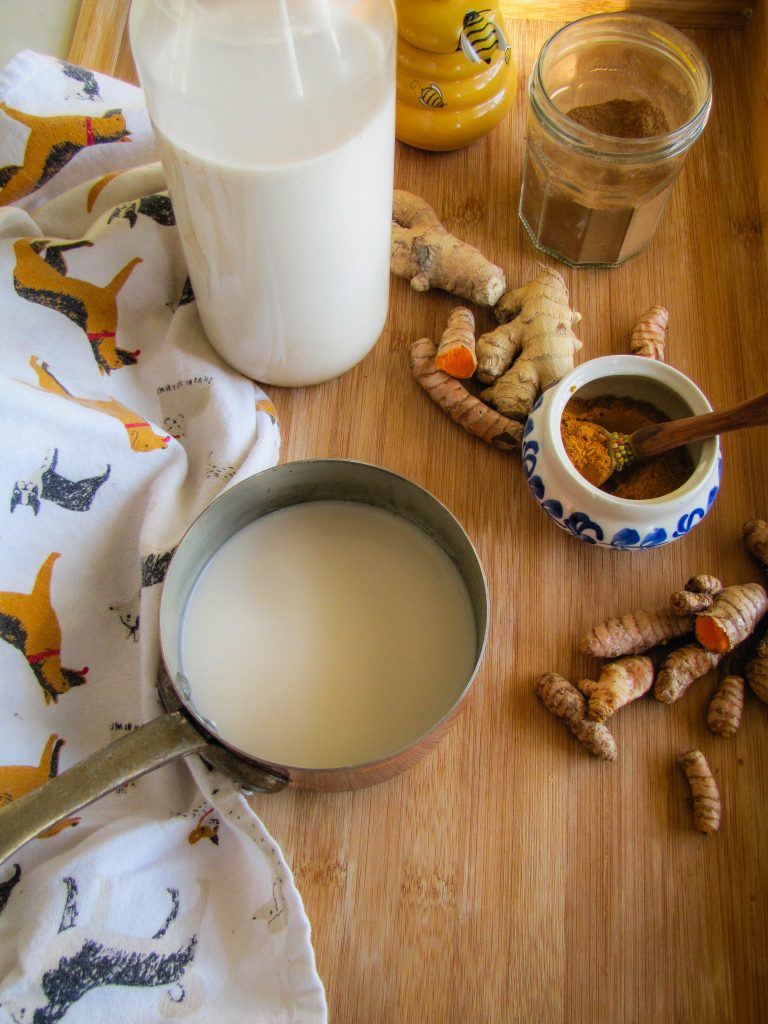 making golden milk with homemade almond milk