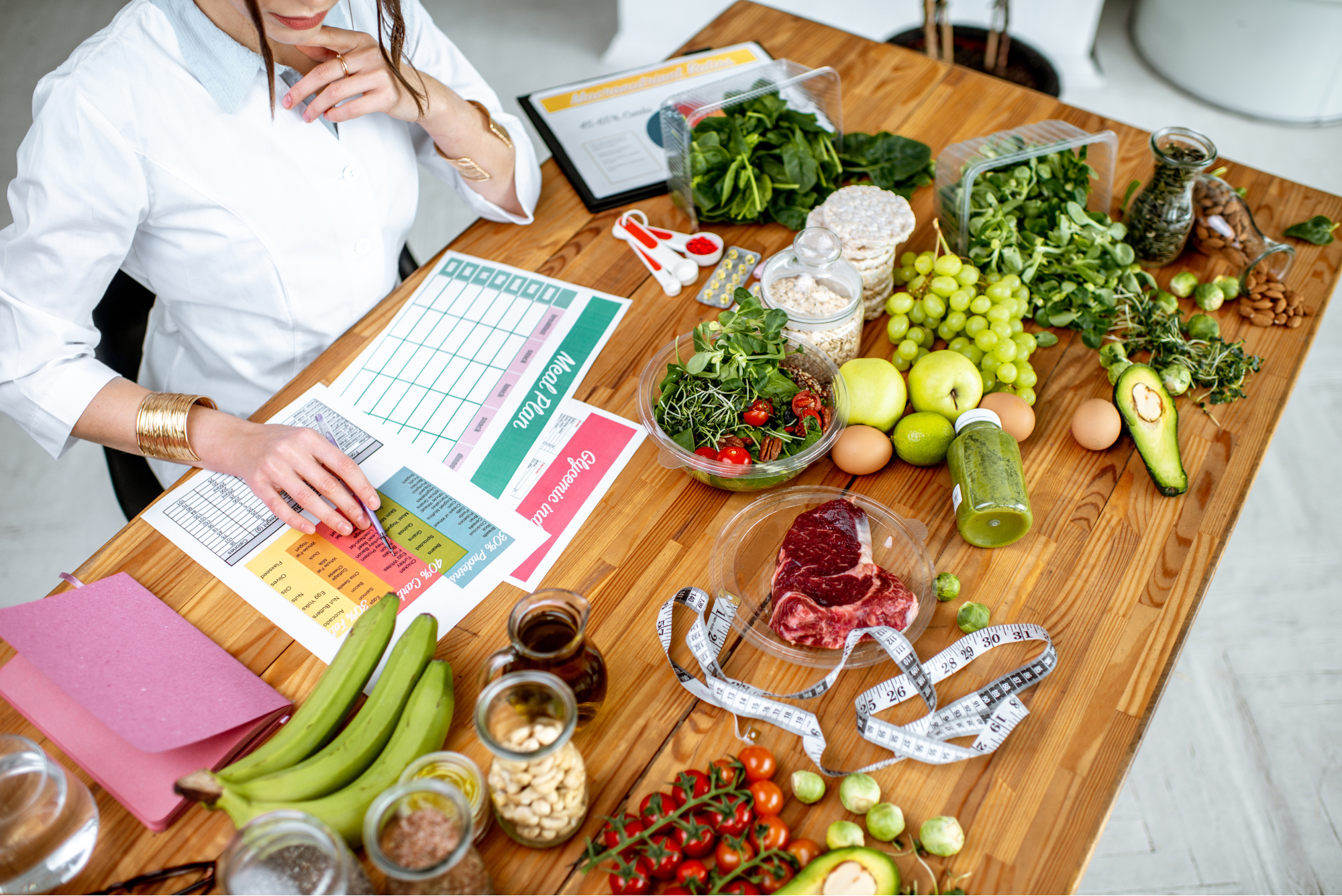 Dietitian writing a health plan for a client