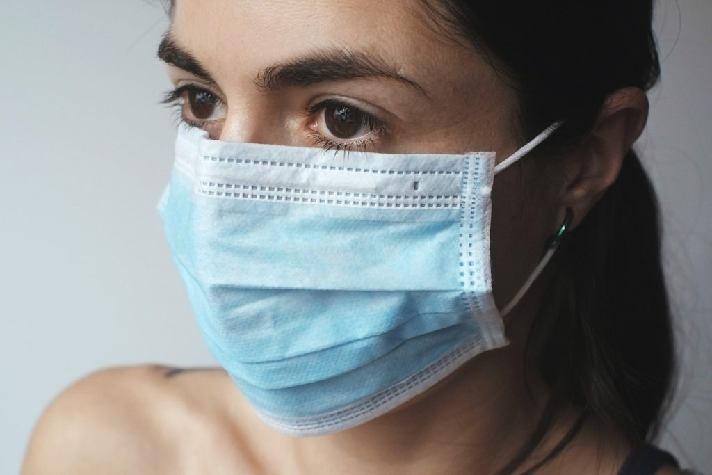 A person wearing a medical face mask
